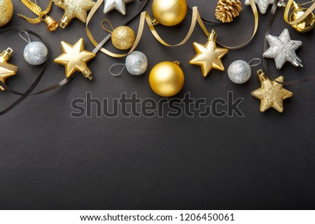 Beautiful christmas golden silver deco baubles on dark black background. Flat lay design. Copy Space. Horizontal. #1206450061