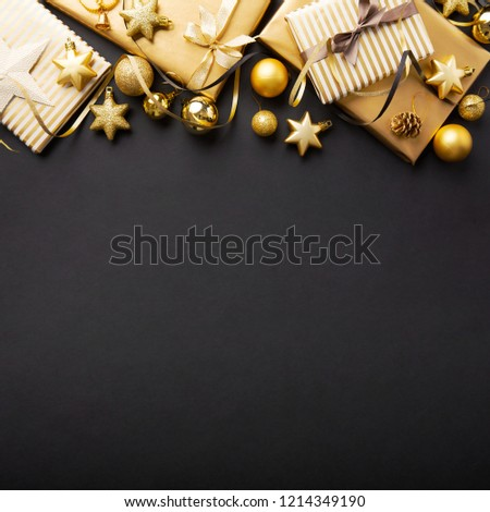 Beautiful christmas golden silver deco baubles with gifts on dark black background. Flat lay design. Copy Space. Square. #1214349190