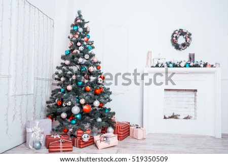 Beautiful Christmas living room with decorated Christmas tree, gifts and fireplace. The idea for postcards