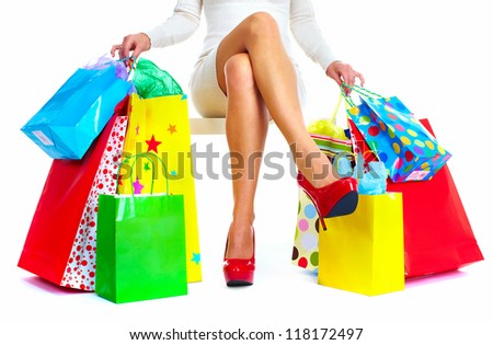 Beautiful Christmas Shopping woman with bags isolated on white background.