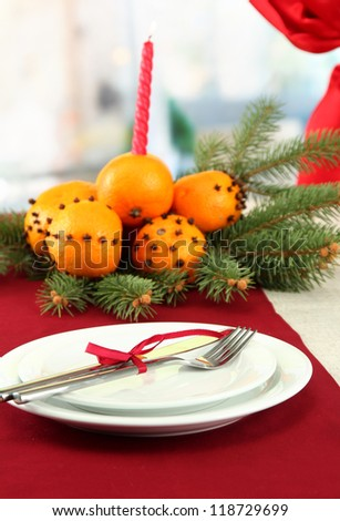 beautiful christmas table setting with tangerines and fir tree, close up