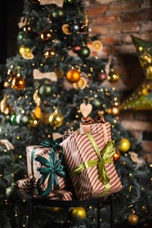 Beautiful Christmas tree and gifts. New Years Eve. Waiting for gifts. 2021