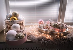 Beautiful Christmas tree baubles and fairy lights on window sill indoors