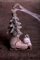Beautiful christmas tree decoration small ice skates on vintage wooden table.