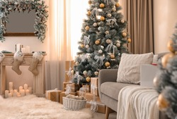 Beautiful Christmas tree in decorated living room. Festive interior