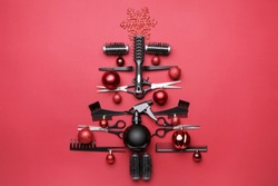 Beautiful Christmas tree made of hairdresser tools on color background
