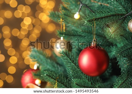 Beautiful Christmas tree with decor against blurred lights on background #1495493546