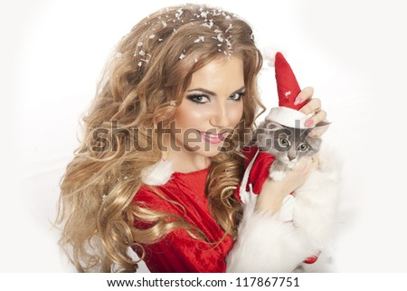 Beautiful christmas woman in Santa Clause costume with extra long curly hair. winter portrait of sexy santa girl with copy space. attractive new year and xmas party lady, isolated on white background - stock photo