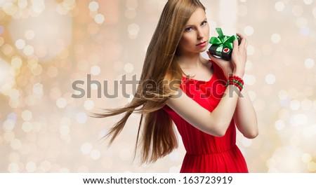beautiful christmas woman with gifts box