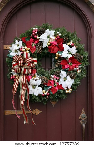 beautiful christmas wreath on brown door