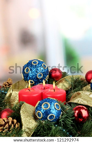 Beautiful Christmas wreath on room background