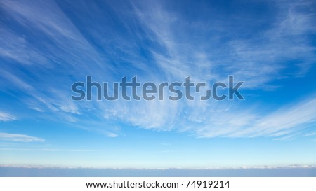 Beautiful cirrus clouds against the blue sky #74919214