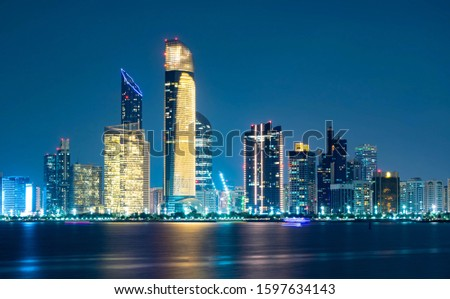 Beautiful City night view of Abu Dhabi financial and commercial district, taken during blue hour, view from marina backwater, United Arab Emirates, luxury life style, business in UAE,  Сток-фото ©
