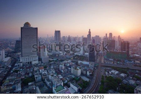 beautiful city scape urban scene  of bangkok capital of thailand in morning light glow up view from peak of sky scrapper building