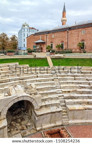 Beautiful cityscape of the public Dzhumaya square in Plovdiv, Bulgaria, with the sfendona of the ruins of the Roman Stadium of Philipopolis and the ancient Ottoman Mosque #1108254236