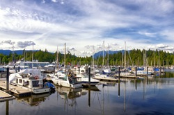 Beautiful cityscape of Vancouver. White Yachts in marina, British Columbia Canada