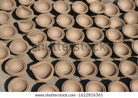 beautiful clay made lanterns placed in a row at potters shop for sale