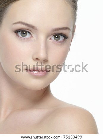 Beautiful clean face of young sexy woman looking at camera -  on  white background