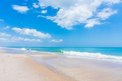 Beautiful clean sandy beach with white sea wave in spring in Melbourne Beach, Florida