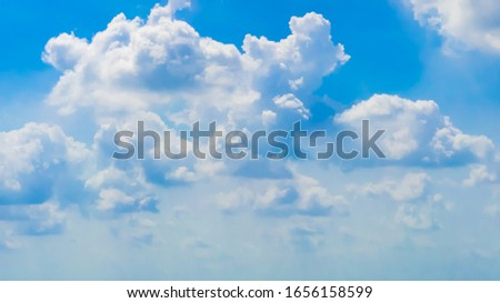 Beautiful clear blue sky with white clouds background. Soft white clouds in the blue sky high beautiful cloud space weather beautiful blue sky glow clouds .background.