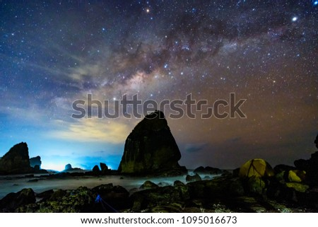 Beautiful clear night stars at Tanjung Papuma beach, Jember, East Java, Indonesia #1095016673