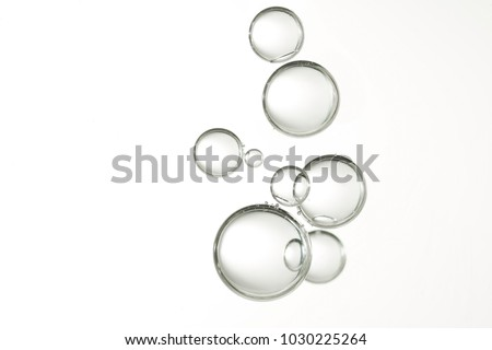 Beautiful clear water bubbles isolated over a gradient background.