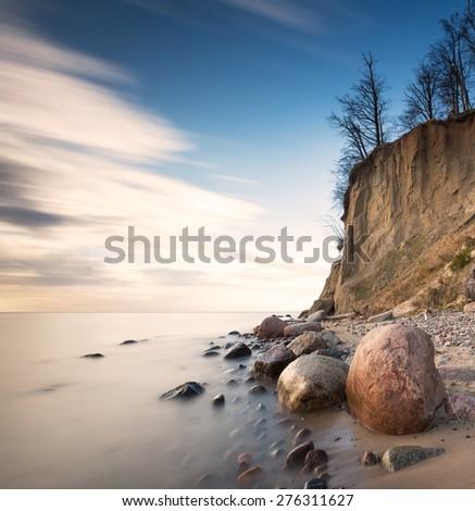Beautiful cliff on sea shore. Long exposure photo. Cliff in Orlowo, Gdynia.