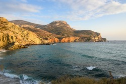 Beautiful cliffs on Agali beach on Folagandros island during sunset. Cyclades, Greece