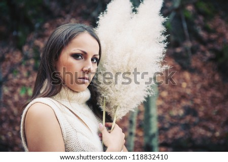 Beautiful close up portrait of young woman in the woods.