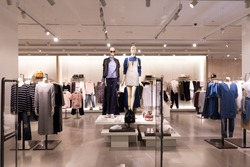 beautiful clothes in modern fashion shop