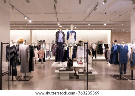 beautiful clothes in modern fashion shop