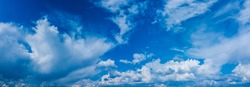 Beautiful cloud pattern in the blue sky. Panoramic view of skyscape.