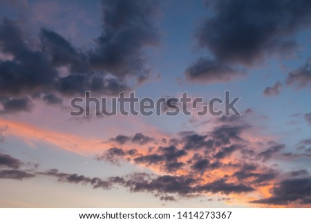 Beautiful clouds and blue sky background at sunset with pink and purple tones over England UK. Cloudscape and skyscape backdrop #1414273367