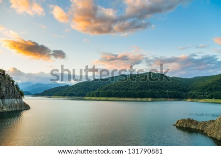 beautiful clouds at sunset over mountain lake