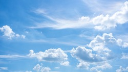 Beautiful clouds during spring time in a Sunny day. Blue sky and white fluffy clouds