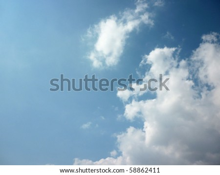 Beautiful clouds over blue sky. Perfect for background usage - stock photo