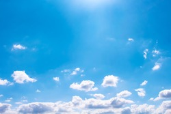 Beautiful clouds patterns on bright blue sky background