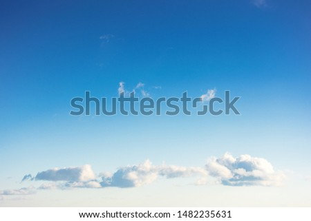 beautiful cloudscape in evening light. fluffy clouds on the blue sky #1482235631