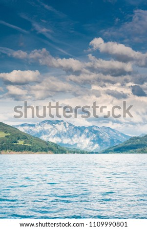Beautiful cloudscape over mountains and lake at Wolfgangsee,Austria. #1109990801