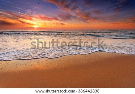 Beautiful cloudscape over the sea, sunrise shot. #386442838