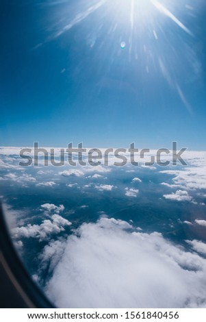 Beautiful cloudscape with large number of big puffy clouds #1561840456