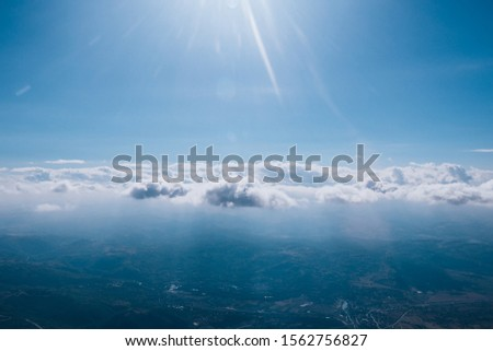 Beautiful cloudscape with large number of big puffy clouds #1562756827