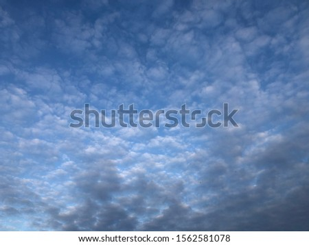 Beautiful cloudscape, with light creating an fading effect #1562581078