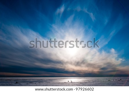 Beautiful cloudy and blue sky over ice lake in Saint-Petersburg, Russia