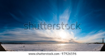 Beautiful cloudy and blue sky panorama over ice lake in Saint-Petersburg, Russia #97926596