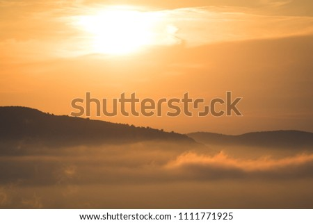 Stock Photo Beautiful cloudy fogy sunset / sunrise on top of France