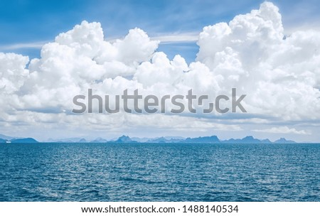 Beautiful cloudy seascape with coastal cliffs visible in the distance