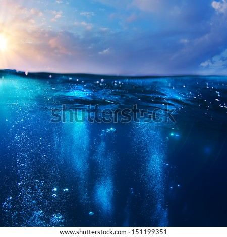 beautiful cloudy sunrise on the sea with splitted by waterline underwater part as design template - Shutterstock ID 151199351