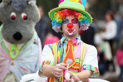 beautiful clown posing in the street