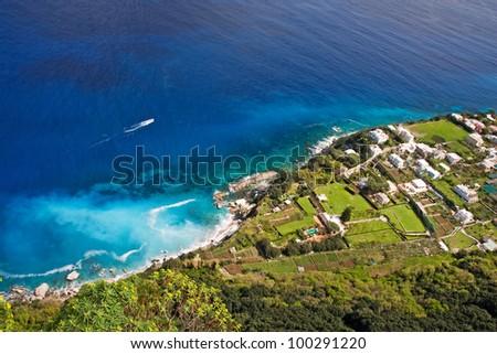 beautiful coast with boat on capri island, italy